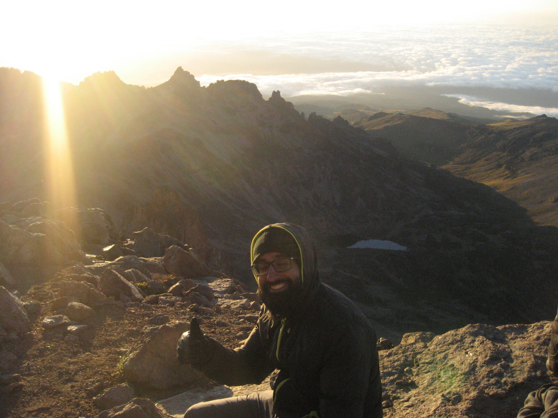 Sunrise from above the clouds at Lenana peak, Mount Kenya, in 2018.